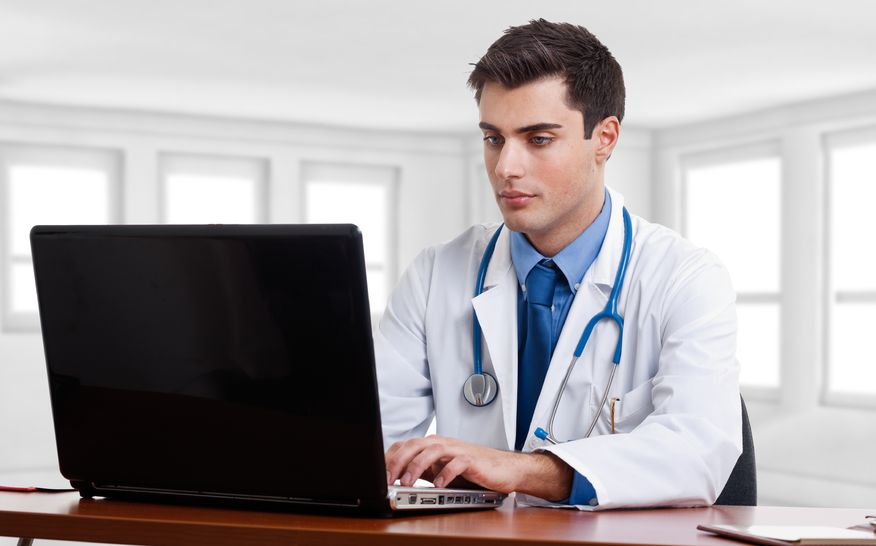 Doctor using electronic intake forms
