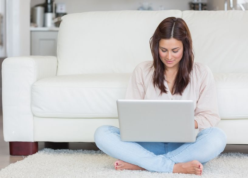 Woman filling out electronic intake form at home